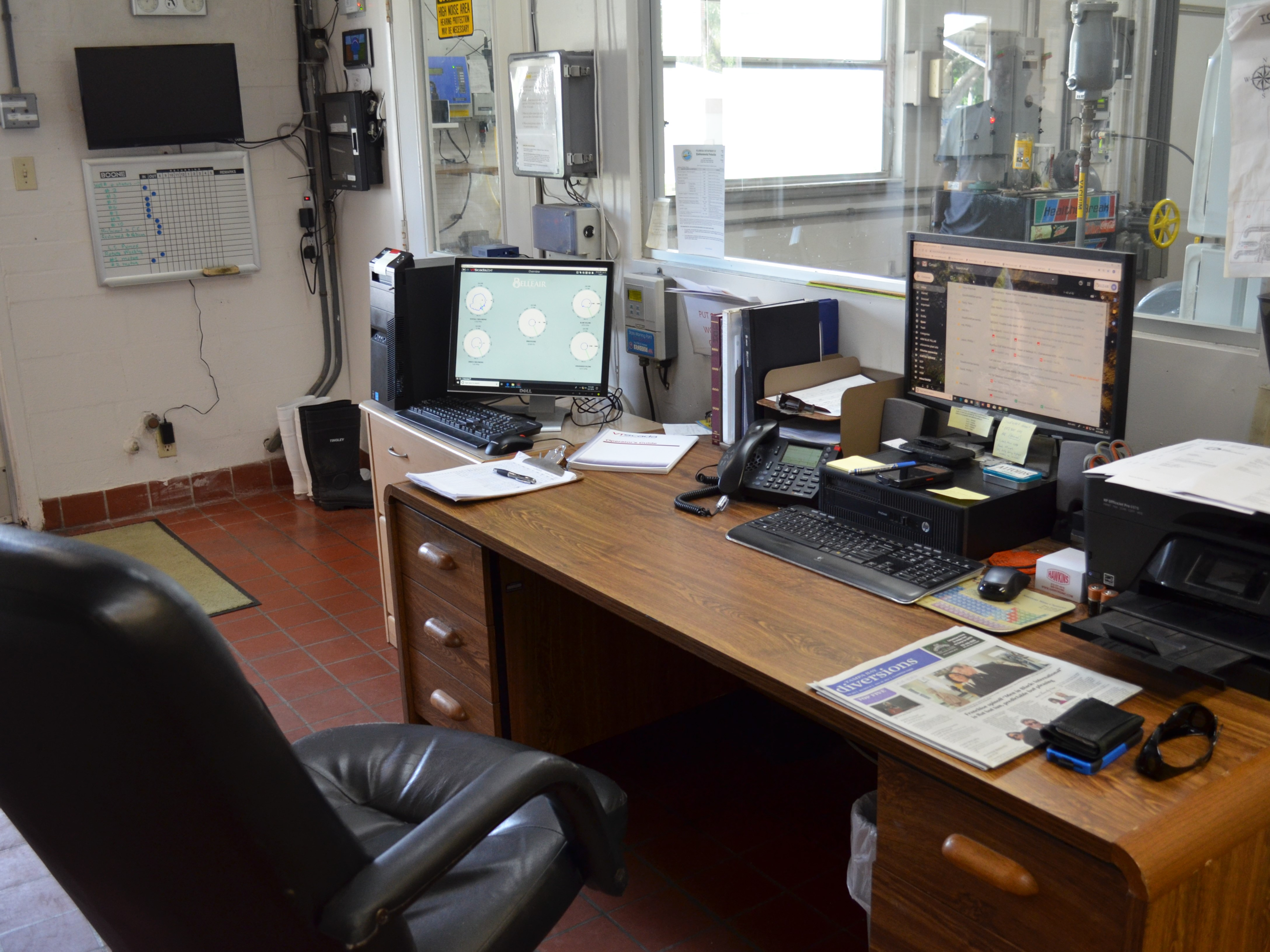 Inside the water plant, an office space for monitoring water treatment from computer systems.